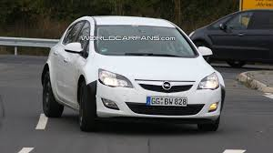 mystery opel mule spied with enlarged new astra body possible