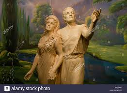life sized statue of adam and eve inside the visitor center temple