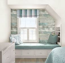 create an accent wall with weathered wood wallpaper for a beachy
