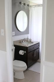 bathroom round mirror bathroom makeover with bold paint vanity lights dark grey walls