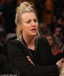 kaley cuoco bunches her hair up to watch la lakers lose to the