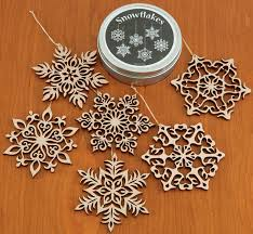 of six wooden snowflake ornaments in gift tin