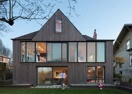 what makes a house a tudor tudor style home in seattle gets a bold modern rear facade