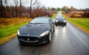 maserati wrapped peak performers 2012 jaguar xkr s and 2012 maserati granturismo