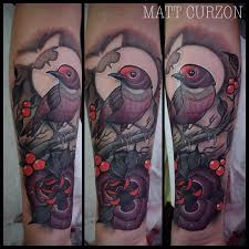 neo traditional style colored forearm of big bird with flower