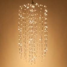 falling willow lighted branches with warm white led twinkle lights
