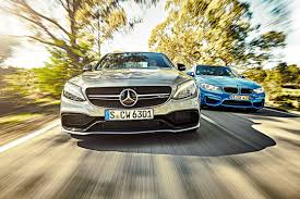mercedes dealership inside mercedes amg c63 vs bmw m3 twin test review 2015 by car magazine