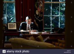 Resolute Desk Us President Barack Obama Writing At The Resolute Desk In The Oval