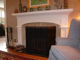 light green marble fireplace surround with shelf plus gray tiled