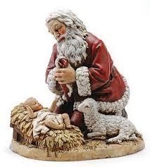 santa kneeling at the manger christmas creche pedagogical pilgrim