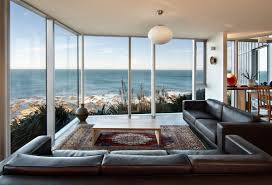 cliff top home with spectacular views in wellington new zealand brown leather sofa glass walls ocean views cliff top home with spectacular