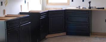 installing a kitchen base cabinet assembling a corner sink base cabinet kick or die