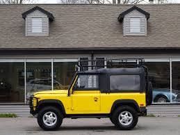 land rover yellow 1997 land rover defender 90 convertible copley motorcars