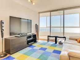 modern ocean view condo with a balcony u0026 a shared pool tub