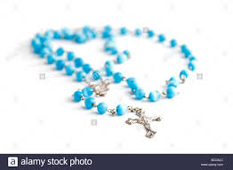 pale blue rosary on a white background stock photo 24876836
