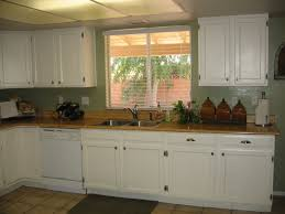 painting kitchen cabinets butcher block counter tops against the