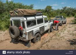 land rover africa auto mechanic working on broken down land rover in botswana