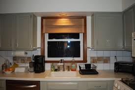 bay window kitchen nook u shaped stone grill island single blue