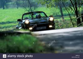 porsche 911 dark green car porsche 911 sc convertible model year 1983 1989 this