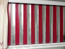 we painted the vertical blinds red and silver to match the rest of