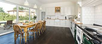using bright shaker style kitchen cabinets in an open concept east