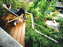 Sloping Backyard Ideas Sloped Backyard With Floating Deck Stylish Outdoor Photo With