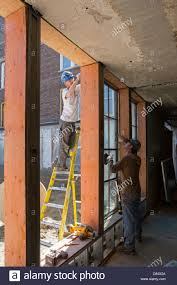 workers renovate historic high in detroit stock photo