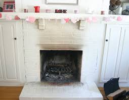 nice white brick wall painted fireplace and floating shelf as