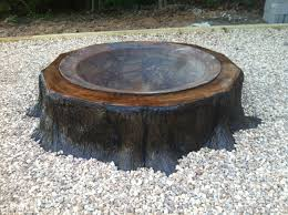 How To Create A Fire Pit In Your Backyard by Build A Fire Pit Around An Old Tree Stump And Its A Cool Way To
