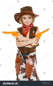 little wearing cowboy costume holding stock photo 123923485