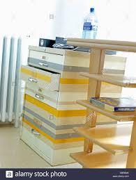 Yellow Metal Filing Cabinet Pale Wood Shelves Beside Metal Filing Cabinet Painted In Orange