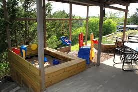 image detail for the under deck sandbox and playground between