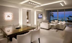 square wooden table comfy white sofas white chair wall lamp design