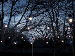 how to string cafe lights how to hang outdoor string lights from diy posts hgtv