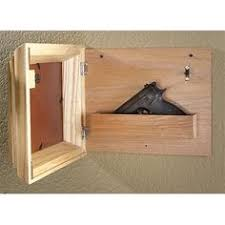 Building A Gun Cabinet Excellent Idea For Usage Of Wasted Space Among Bookshelves In A