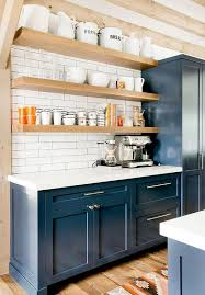 kitchen cabinet with shelves navy blue shaker cabinets with blond floating shelves