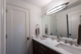 jack u0026 jill bathroom with a paint grade mdf door casually elegant