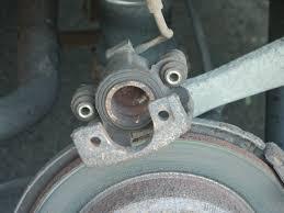 crown victoria rear brake caliper confusion phenolic or steel