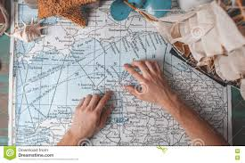 World Map Desk by Man U0027s Hand On Map On Desk With Traveller Attributes Stock Photo