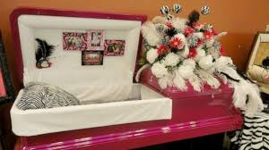 pink casket caskets and cremation urns sold in shopping malls abc news