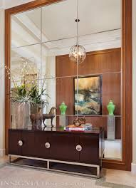 mirror wall opposite a wood panel wall for foyer walk in
