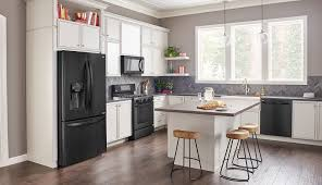 white kitchen cabinets and black stainless steel appliances top seven kitchen trends of 2019 sandpiper supply
