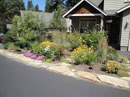 how to design rock garden strip next to driveway google search