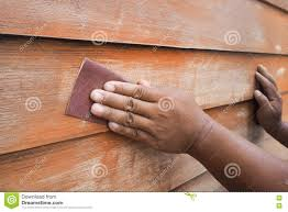 human hands scrubbing wood wall by sandpaper stock photo image
