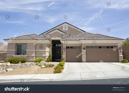 tan two story stucco modern home stock photo 5049775 shutterstock
