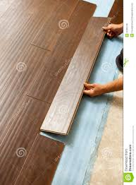 Laying Laminate Hardwood Flooring Man Installing New Laminate Wood Flooring Royalty Free Stock