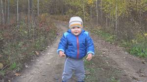 cute baby boy autumn leaves wallpapers the one year old cute baby boy is making his first steps in autumn