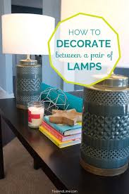 Decorate A Sofa Table How To Decorate Between A Pair Of Lamps Video Of Decorating