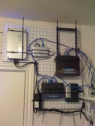 home network closet design attach all home network gear to a pegboard to make it easily