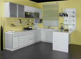 small kitchen with white cabinets and yellow paint color images